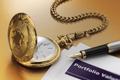 Pocket watch and pen. Gold pocket watch with pen and portfolio statement with selective focus Stock Image