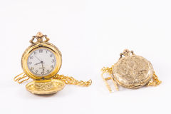 Pocket watch. Picture of the old pocket watch isolated on the white background. Open and Closed version Royalty Free Stock Photography
