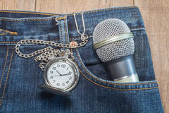 Pocket watch in pocket of jeans Stock Photos