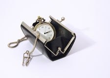Pocket watch into purse Royalty Free Stock Images
