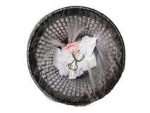 Pocket watch in refuse bin. Royalty Free Stock Image