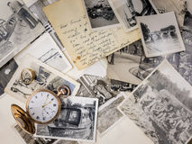 Pocket watch and ring with old photographs Royalty Free Stock Images