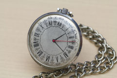 Pocket watch with Roman numerals. Old pocket watch with its Roman tsyfry on the dial stock images
