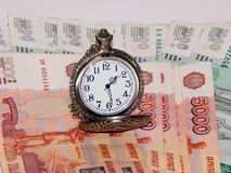 Pocket watch with Russian money Royalty Free Stock Photo