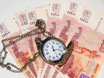 Pocket watch with Russian money Royalty Free Stock Images