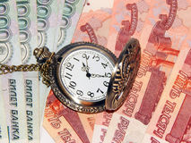 Pocket watch with Russian money Stock Photography