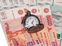 Pocket watch with Russian money Stock Photo