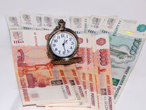 Pocket watch with Russian money Stock Images
