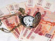 Pocket watch with Russian money Stock Photos