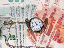 Pocket watch with Russian money Royalty Free Stock Photography
