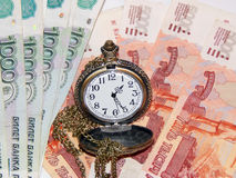 Pocket watch with Russian money. The concept of time is money. Close up Royalty Free Stock Photography