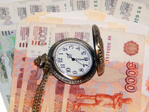Pocket watch with Russian money. The concept of time is money. Close up Stock Photo