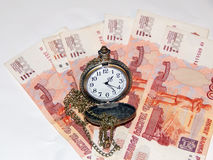 Pocket watch with Russian money. The concept of time is money. Close up Stock Photos