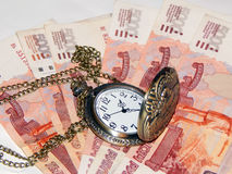 Pocket watch with Russian money. The concept of time is money Royalty Free Stock Photography
