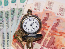 Pocket watch with Russian money. The concept of time is money. Close up Royalty Free Stock Images