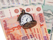 Pocket watch with Russian money. The concept of time is money. Close up Royalty Free Stock Image