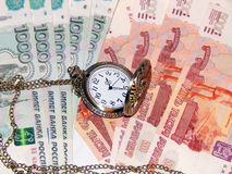 Pocket watch with Russian money. The concept of time is money. Close up Stock Photography