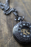 Pocket watch on rustic wooden background Royalty Free Stock Image