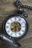 Pocket watch on rustic wooden background Stock Photos