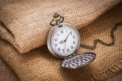 Pocket watch on sackcloth Stock Image