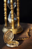 Pocket watch and sandglass Royalty Free Stock Photo