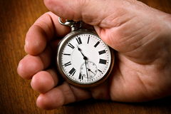 Pocket watch in senior man's hand Stock Photo