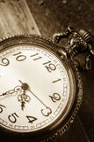 Pocket watch,sepia color filtered. Royalty Free Stock Image