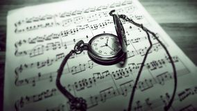 Pocket watch on sheet music