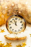 Pocket watch showing five minutes to midnight. Stock Image