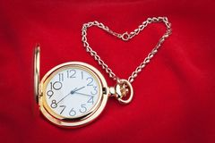 Pocket watch and silver chain. Stock Images