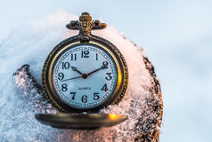 Pocket watch in the snow Royalty Free Stock Photos