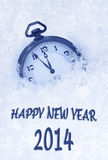 Pocket watch in snow, Happy New Year 2014 greeting card Stock Photos