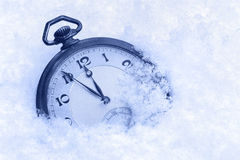 Pocket watch in snow, Happy New Year greeting card Stock Image