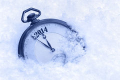 Pocket watch in snow, New Year 2014 greeting Stock Images
