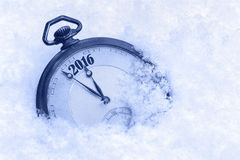Pocket watch in snow, New Year 2016 greeting Royalty Free Stock Photos