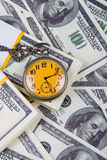 Pocket watch on a stack of dollars Stock Images