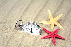 Pocket watch with starfish on the beach Stock Photography
