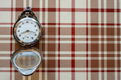 Pocket watch on table cloth Stock Image