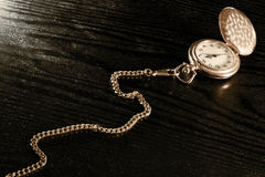 Pocket watch on a table Stock Image