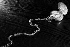 Pocket watch on a table Stock Photo