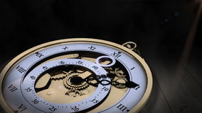 Pocket watch ticking on wooden surface stock footage