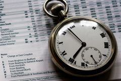 Pocket watch on timetable Royalty Free Stock Images