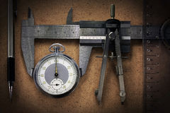 Pocket Watch wiht tools Royalty Free Stock Images