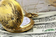 Pocket watch and US currency Royalty Free Stock Photography
