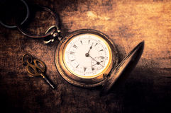 Pocket watch. Vintage grunge still life with pocket watch.Selective focus in the middle of pocket watch Stock Photography