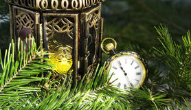 Pocket watch and vintage lantern with conifer branches Stock Image