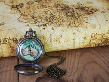 Pocket watch on vintage map. Retro style.  Royalty Free Stock Image