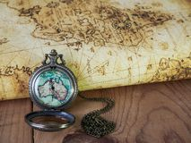 Pocket watch on vintage map. Retro style. A Pocket watch on vintage map. Retro style Stock Photos