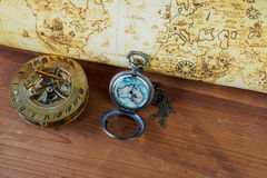 Pocket watch on vintage map. Retro style. On wodd Royalty Free Stock Photography