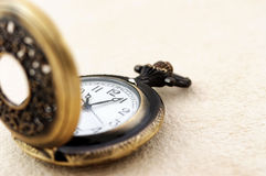 Pocket watch on vintage paper Royalty Free Stock Photo